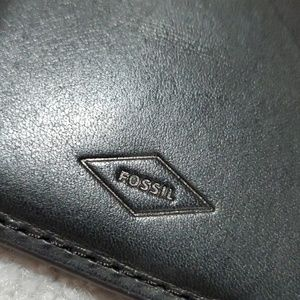 Fossil black and brown leather cardholder.